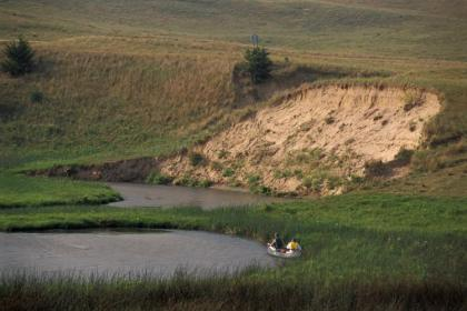 Canoers on the Calamus River. © NEBRASKAland Magazine/Nebraska Game and Parks Commission.