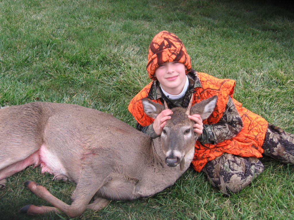 my son noah proudly poses with his whitetail spike buck